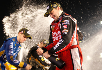 RICHMOND, VA - SEPTEMBER 10:  Brad Keselowski, driver of the #2 Miller Lite Dodge, and Tony Stewart, driver of the #14 Office Depot/Mobil 1 Chevrolet, celebrate after clinching a spot in the 'Chase for the Sprint Cup' following the NASCAR Sprint Cup Serie