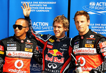 MONZA, ITALY - SEPTEMBER 10:  Pole sitter Sebastian Vettel (C) of Germany and Red Bull Racing celebrates in parc ferme with second placed Lewis Hamilton (L) of Great Britain and McLaren and third placed Jenson Button (R) of Great Britain and McLaren quali