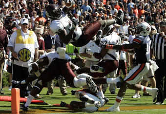 Bulldog, Vick Ballard, dives towards the Auburn goal
