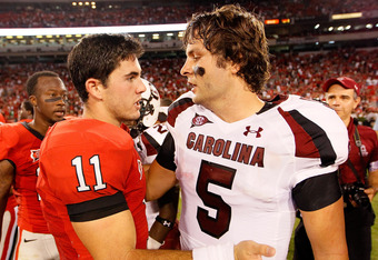 Quarterbacks Murray (11) and Garcia (5) post game