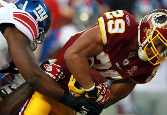 LANDOVER, MD - SEPTEMBER 11:   Roy Helu #29 of the Washington Redskins runs the ball against Antrel Rolle #26 and Jimmy Kennedy #73 of the New York Giants during the season opener at FedExField on September 11, 2011 in Landover, Maryland.  (Photo by Ronal