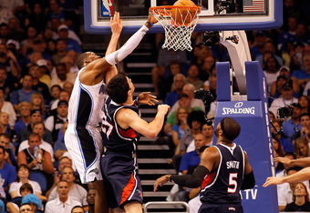 ORLANDO, FL - APRIL 26:  Dwight Howard #12 of the Orlando Magic dunks over Zaza Pachulia #27 of the Atlanta Hawks during Game Five of the Eastern Conference Quarterfinals of the 2011 NBA Playoffs on April 26, 2011 at the Amway Arena in Orlando, Florida.