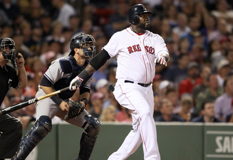 BOSTON, MA - AUGUST 31:  David Ortiz #34 of the Boston Red Sox watches his two run homer in the fifth inning as Francisco Cervelli #17 of the New York Yankees stands by on August 31, 2011 at Fenway Park in Boston, Massachusetts.  (Photo by Elsa/Getty Imag
