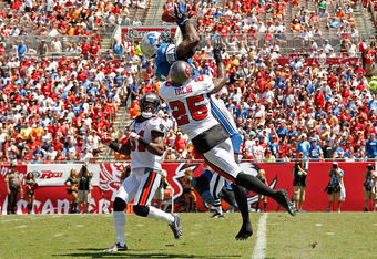 TAMPA, FL - SEPTEMBER 11:  Calvin Johnson #81 of the Detroit Lions goes up for a catch against  E.J. Biggers #31 and  Aqib Talib #25 of the Tampa Bay Buccaneers in the season opener at Raymond James Stadium on September 11, 2011 in Tampa, Florida.  (Photo