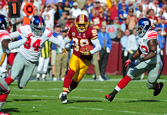 LANDOVER, MD - SEPTEMBER 11: Santana Moss #89 of the Washington Redskins runs with a catch against the New York Giants during the season-opening game at FedEx Field on September 11, 2011 in Landover, Maryland. (Photo by Scott Cunningham/Getty Images)