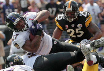 BALTIMORE, MD - SEPTEMBER 11: Running back Ray Rice #27 of the Baltimore Ravens dives into the end zone for a touchdown against the Pittsburgh Steelers during the season opener at M&T Bank Stadium on September 11, 2011 in Baltimore, Maryland.  (Photo by R