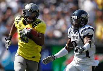 EUGENE, OR - SEPTEMBER 10:  Daryle Hawkins #16 of the Oregon Ducks runs with the ball against Khalid Wooten #2 of the Nevada Wolf Pack on September 10, 2011 at the Autzen Stadium in Eugene, Oregon.  (Photo by Jonathan Ferrey/Getty Images)