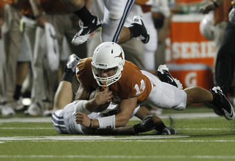 Freshman David Ash provides some tough running for the young Longhorns.