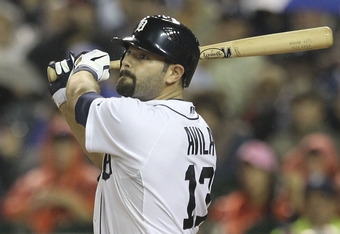 DETROIT - SEPTEMBER 09:  Alex Avila #13 of the Detroit Tigers hits a three-run home run in the second inning during the game against the Minnesota Twins at Comerica Park on September 9, 2011 in Detroit, Michigan.  (Photo by Leon Halip/Getty Images)