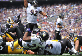 BALTIMORE, MD - SEPTEMBER 11:  Ray Rice #27 of the Baltimore Ravens scores a touchdown against the Pittsburgh Steelers at M&T Bank Stadium on September 11, 2011 in Baltimore, Maryland. The Ravens defeated the Steelers 35-7. (Photo by Larry French/Getty Im