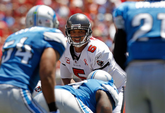 TAMPA, FL - SEPTEMBER 11:  Josh Freeman #5 of the Tampa Bay Buccaneers takes a snap during the season opener against the Detroit Lions at Raymond James Stadium on September 11, 2011 in Tampa, Florida.  (Photo by Mike Ehrmann/Getty Images)