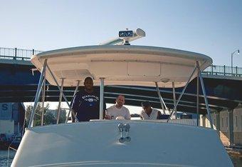 Genghis, Juan Carlos and Carlos Villa cruising on a yacht