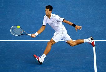 NEW YORK, NY - SEPTEMBER 12:  Novak Djokovic of Serbia hits a return against Rafael Nadal of Spain during the Men's Final on Day Fifteen of the 2011 US Open at the USTA Billie Jean King National Tennis Center on September 12, 2011 in the Flushing neighbor