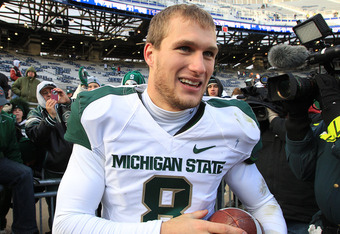 STATE COLLEGE, PA - NOVEMBER 27: Quarterback Kirk Cousins #8 of the Michigan State Spartans leaves the field after winning the Big Ten championship after a game against the Penn State Nittany Lions on November 27, 2010 at Beaver Stadium in State College,