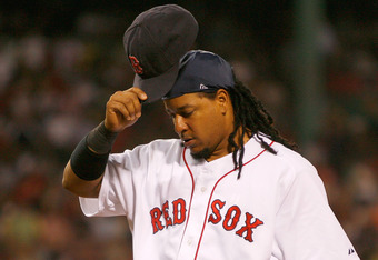 BOSTON - JULY 30: Manny Ramirez #24 of the Boston Red Sox removes his cap as he walks off of the field against the Los Angeles Angels of Anaheim at Fenway Park on July 30, 2008 in Boston, Massachusetts.  (Photo by Jim Rogash/Getty Images)