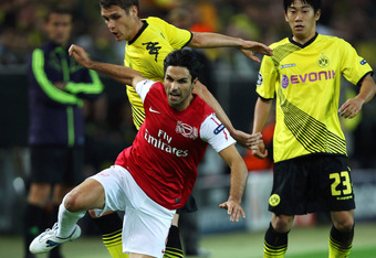 DORTMUND, GERMANY - SEPTEMBER 13:  Mikel Arteta (L) of Arsenal is tackled by Sebastian Kehl of Borussia Dortmund during the UEFA Champions League Group F match between Borussia Dortmund and Arsenal FC at Signal Iduna Park on September 13, 2011 in Dortmund