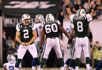 EAST RUTHERFORD, NJ - SEPTEMBER 11:  Nick Folk #2 and Mark Brunell #8 of the New York Jets celebrate after Folk kicked a successful 50-yard game-winning field goal against the Dallas Cowboys during their NFL Season Opening Game at MetLife Stadium on Septe
