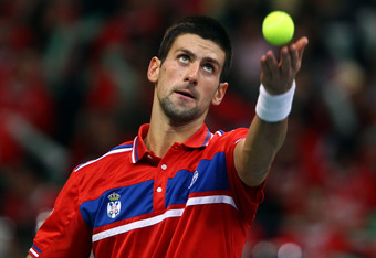BELGRADE, SERBIA - DECEMBER 03:  Novak Djokovic of Serbia serves to Gilles Simon of France during day one of the Davis Cup Tennis Final at the Begrade Arena on December 3, 2010 in Belgrade, Serbia.  (Photo by Julian Finney/Getty Images)