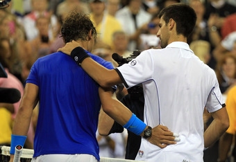 NEW YORK, NY - SEPTEMBER 12:   Rafael Nadal of Spain congratulates  Novak Djokovic of Serbia after Djokovic won the Men's Final on Day Fifteen of the 2011 US Open at the USTA Billie Jean King National Tennis Center on September 12, 2011 in the Flushing ne