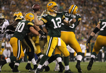 GREEN BAY, WI - SEPTEMBER 08:  Aaron Rodgers #12 of the Green Bay Packers throws a pass against the New Orleans Saints during the NFL opening season game at Lambeau Field on September 8, 2011 in Green Bay, Wisconsin. The Packers defeated the Saints 42-34.