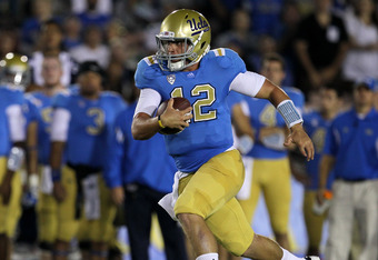PASADENA, CA - SEPTEMBER 10:  Quarterback Richard Brehaut #12 of the UCLA Bruins carries the ball against the San Jose State Spartans at the Rose Bowl on September 10, 2011 in Pasadena, California.  UCLA won 27-17.  (Photo by Stephen Dunn/Getty Images)
