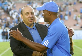 UCLA Athletic Director Dan Guerrero with former Bruin football coach Karl Dorrell
