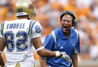 KNOXVILLE, TN - SEPTEMBER 12: Rick Neuheisel, head coach of the UCLA Bruins yells at Taylor Embree #82 of the UCLA Bruins against the Tennessee Volunteers on September 12, 2009 at Neyland Stadium in Knoxville, Tennessee. UCLA beat Tennessee 19-15. (Photo