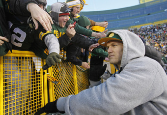 GREEN BAY, WI - FEBRUARY 08:  Green Bay Packers linebacker Clay Matthews slaps the hands of fans as he leaves the field after the Packers victory ceremony at Lambeau Field on February 8, 2011 in Green Bay, Wisconsin.  (Photo by Matt Ludtke/Getty Images)