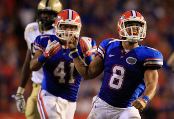 GAINESVILLE, FL - SEPTEMBER 10:  Trey Burton #8 of the Florida Gators celebrates following a run during a game against the UAB Blazers at Ben Hill Griffin Stadium on September 10, 2011 in Gainesville, Florida.  (Photo by Sam Greenwood/Getty Images)