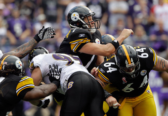 BALTIMORE, MD - SEPTEMBER 11: Quarterback  Ben Roethlisberger #7 of the Pittsburgh Steelers is hit by defender  Jarret Johnson #95 of the Baltimore Ravens after releasing the ball during second half of the season opener at M&T Bank Stadium on September 11
