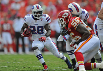 KANSAS CITY, MO - SEPTEMBER 11:  Running back C.J. Spiller #28 of the Buffalo Bills rushes to the outside against pressure from linebacker Derrick Johnson #56 of the Kansas City Chiefs during the fourth quarter on September 11, 2011 at Arrowhead Stadium i