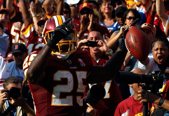 LANDOVER, MD - SEPTEMBER 11:  Running back  Tim Hightower #25 of the Washington Redskins reacts after scoring on a one-yard touchdown run in the second quarter against the New York Giants at FedExField on September 11, 2011 in Landover, Maryland.  (Photo