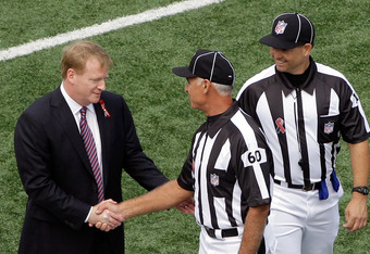 BALTIMORE, MD - SEPTEMBER 11: NFL Commissioner Roger Goodell (L) shakes hands with field judge Gary Cavaletto #60 before the start of the Baltimore Ravens and Pittsburgh Steelers season opener at M&T Bank Stadium on September 11, 2011 in Baltimore, Maryla