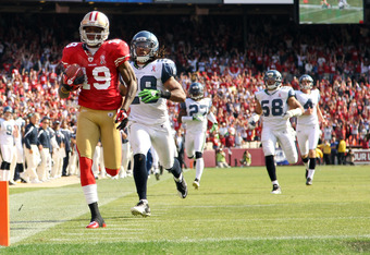 SAN FRANCISCO, CA - SEPTEMBER 11:  Ted Ginn #19 of the San Francisco 49ers outruns Earl Thomas #29 and the rest of the Seattle Seahawks on his way to scoring a touchdown on a kickoff return during their season opener at Candlestick Park on September 11, 2