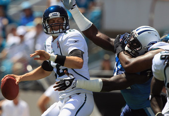 JACKSONVILLE, FL - SEPTEMBER 11:  William Hayes #95 of the Tennessee Titans tries to stop Luke McCown #12 of the Jacksonville Jaguars during their season opener at EverBank Field on September 11, 2011 in Jacksonville, Florida.  (Photo by Streeter Lecka/Ge