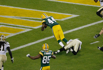 GREEN BAY, WI - SEPTEMBER 8: James Starks #44 of the Green Bay Packers dives in the end zone for a touchdown during the game against the New Orleans Saints at Lambeau Field on September 8, 2011 in Green Bay, Wisconsin. (Photo by Scott Boehm/Getty Images)