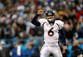 CHARLOTTE, NC - DECEMBER 14:  Jay Cutler #6 of the Denver Broncos celebrates after the Broncos score a touchdown against the Carolina Panthers during their game at Bank of America Stadium on December 14, 2008 in Charlotte, North Carolina  (Photo by Street