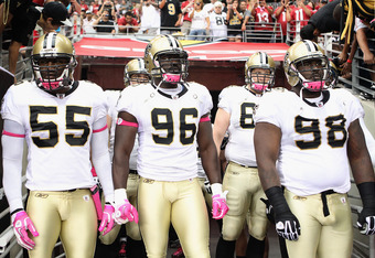 GLENDALE, AZ - OCTOBER 10:  (L-R) Danny Clark #55, Alex Brown #96 and Sedrick Ellis #98 of the New Orleans Saints before the NFL game against the Arizona Cardinals at the University of Phoenix Stadium on October 10, 2010 in Glendale, Arizona.  (Photo by C