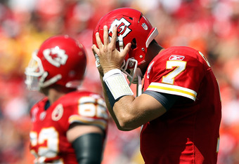 KANSAS CITY, MO - SEPTEMBER 11:  Quarterback Matt Cassel #7 of the Kansas City Chiefs walks off the field holding his head during the game against the Buffalo Bills at Arrowhead Stadium on September 11, 2011 in Kansas City, Missouri.  (Photo by Jamie Squi