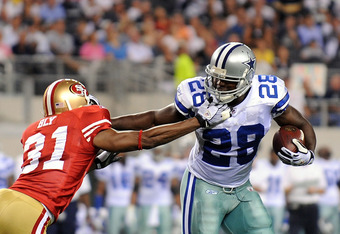 ARLINGTON, TX - AUGUST 29:  Runnng back Felix Jones #28 of the Dallas Cowboys runs the ball against Dre' Bly #31 of the San Francisco 49ers at Cowboys Stadium on August 29, 2009 in Arlington, Texas.  (Photo by Ronald Martinez/Getty Images)