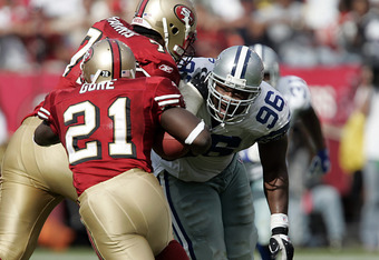 Cowboys defensive end Marcus Spears is taken out of the play by 49ers tackle Kwame Harris as runningback Frank Gore gains a first down in the second half as the Dallas Cowboys defeated the San Francisco 49ers by a score of 34 to 31 at Monster Park, San Fr