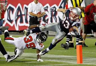 TAMPA, FL - AUGUST 18:  Receiver Wes Welker #83 of the New England Patriots stretches for the goal line as defender Anthony Gaitor #39 of the Tampa Bay Buccaneers stops him during a preseason game at Raymond James Stadium on August 18, 2011 in Tampa, Flor