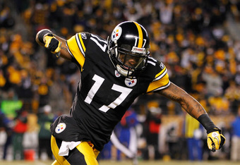 PITTSBURGH, PA - JANUARY 23: Mike Wallace #17 celebrates after Ben Roethlisberger #7 of the Pittsburgh Steelers scored a second quarter touchdown against the New York Jets during the 2011 AFC Championship game at Heinz Field on January 23, 2011 in Pittsbu