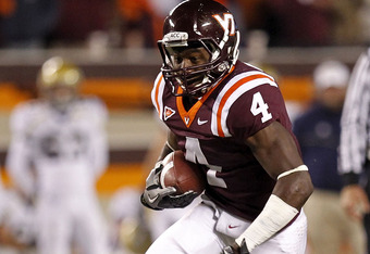 BLACKSBURG, VA - NOVEMBER 04:  Running back David Wilson #4 of the Virginia Tech Hokies runs with the ball against the Georgia Tech Yellow Jackets at Lane Stadium on November 4, 2010 in Blacksburg, Virginia.  (Photo by Geoff Burke/Getty Images)