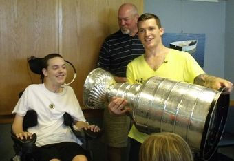 Matt and Mike Brown seem to be enjoying their day with the Cup