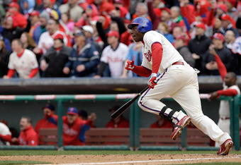 John Mayberry Jr. pumps his fist after hitting a walk-off to help the Phillies win on Opening Day