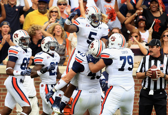 CLEMSON, SC - SEPTEMBER 17:  Michael Dyer #5 of the Auburn Tigers celebrates with teammates after scoring a touchdown against the Clemson Tigers during their game at Memorial Stadium on September 17, 2011 in Clemson, South Carolina.  (Photo by Streeter Le