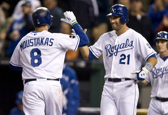 KANSAS CITY, MO - SEPTEMBER 16:   Mike Moustakas #8 of the Kansas City Royals celebrates his two-run home run with Jeff Francoeur #21 in the fourth inning during a game against the Chicago White Sox at Kauffman Stadium on September 16, 2011 in Kansas City