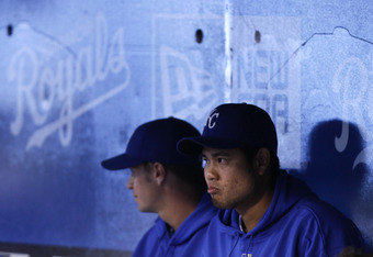KANSAS CITY, MO - SEPTEMBER 15:   Everett Teaford #61 of the Kansas City Royals and Bruce Chen #52 sit in the dugout as they watch warm ups before a game with the Chicago White Sox at Kauffman Stadium on September 15, 2011 in Kansas City, Missouri. (Photo