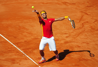 CORDOBA, SPAIN - SEPTEMBER 16:  Rafael Nadal of Spain serves the ball to to Richard Gasquet of France during day one of the semi final Davis Cup match between Spain and France at the Plaza de Toros de los Califas on September 16, 2011 in Cordoba, Spain.